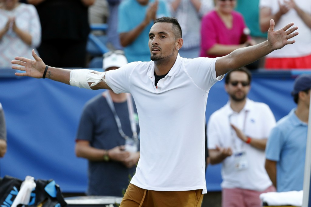 Nick Kyrgios, of Australia, reacts after defeating Daniil Medvedev, of Russia, in a final match at the Citi Open tennis tournament, Sunday, Aug. 4, 20...