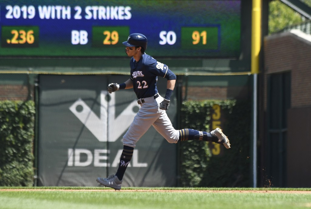 Milwaukee Brewers' Christian Yelich (22) runs the bases after hitting a home run against the Chicago Cubs during the first inning of a baseball game, ...
