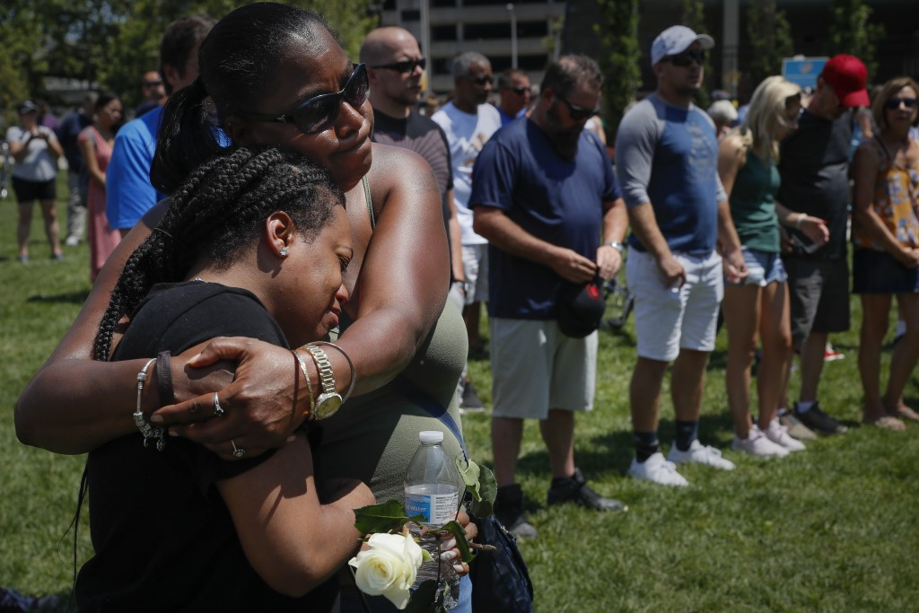 Mourners gather at a vigil following a nearby mass shooting, Sunday, Aug. 4, 2019, in Dayton, Ohio. Multiple people in Ohio have been killed in the se...