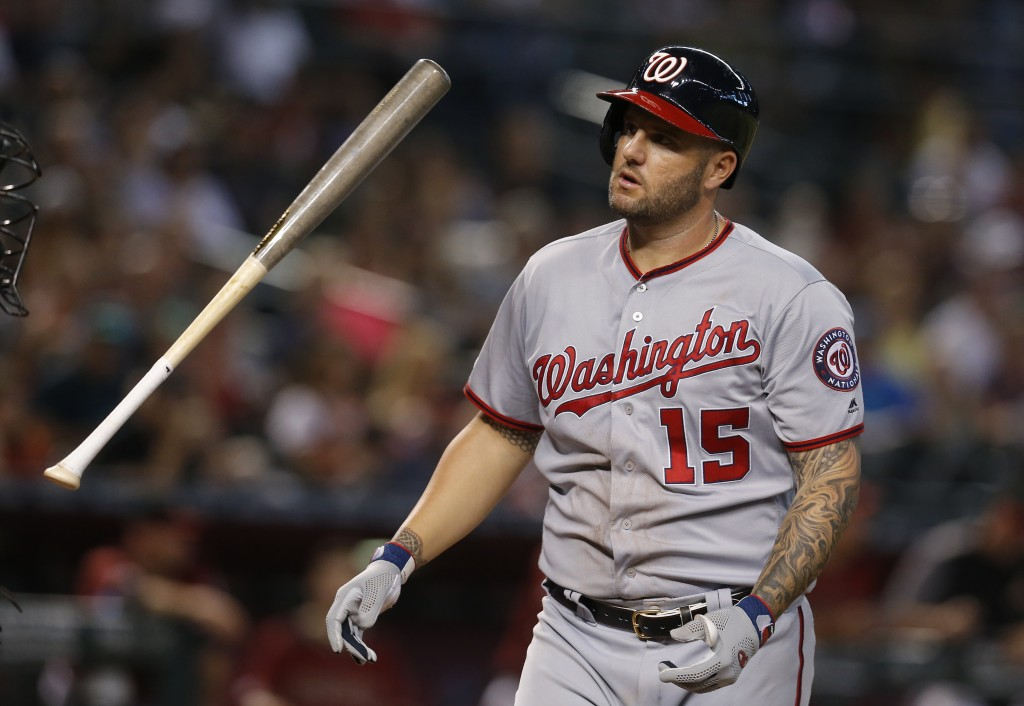 Washington Nationals' Matt Adams reacts after striking out against the Arizona Diamondbacks in the seventh inning during a baseball game, Sunday, Aug....