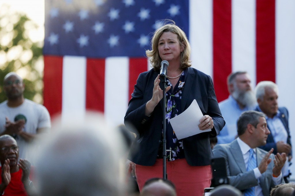 Dayton Mayor Nan Whaley speaks during a vigil at the scene of a mass shooting, Sunday, Aug. 4, 2019, in Dayton, Ohio. A masked gunman in body armor op...