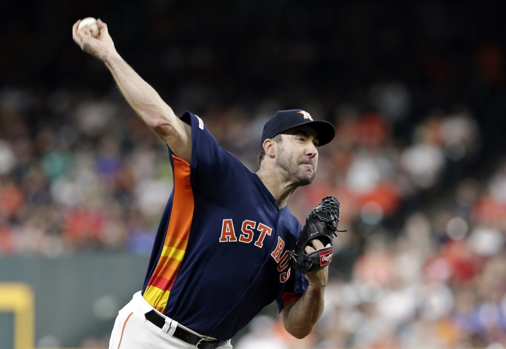 Houston Astros starting pitcher Justin Verlander throws during the first inning of a baseball game against the Seattle Mariners, Sunday, Aug. 4, 2019,...