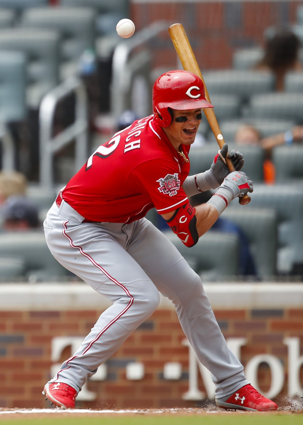 Cincinnati Reds Derek Dietrich (22) is hit by a pitch in the fourth inning of a baseball game against the Atlanta Braves, Sunday, Aug. 4, 2019, in Atl...