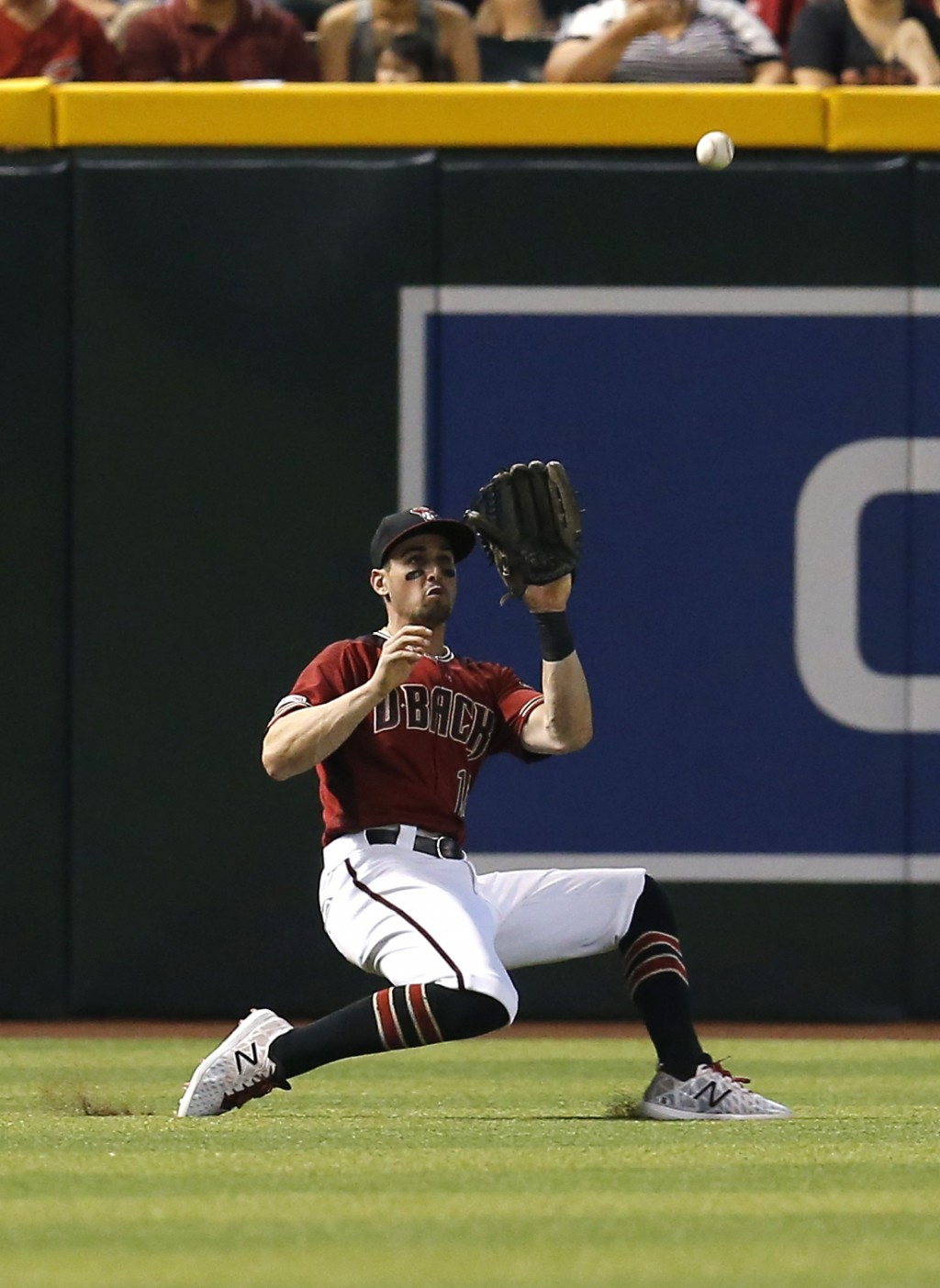 Arizona Diamondbacks left fielder Tim Locastro makes the running catch for an out on a ball hit by Washington Nationals' Patrick Corbin in the fifth i