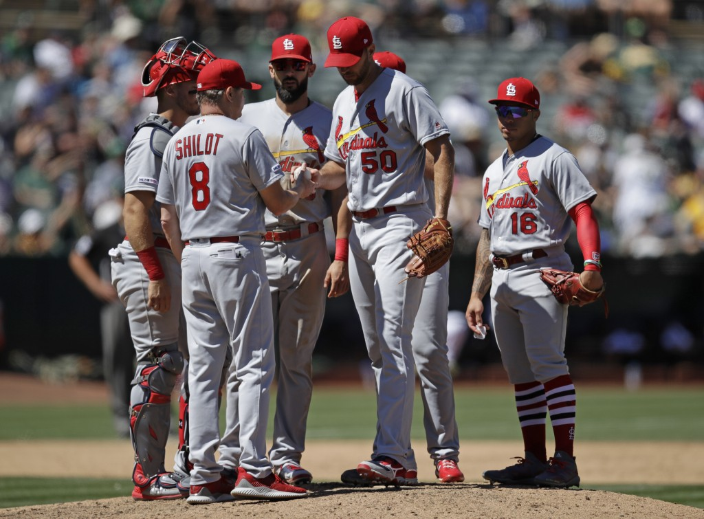 St. Louis Cardinals' Adam Wainwright, center, is relieved by manager Mike Shildt (8) in the sixth inning of a baseball game against the Oakland Athlet...