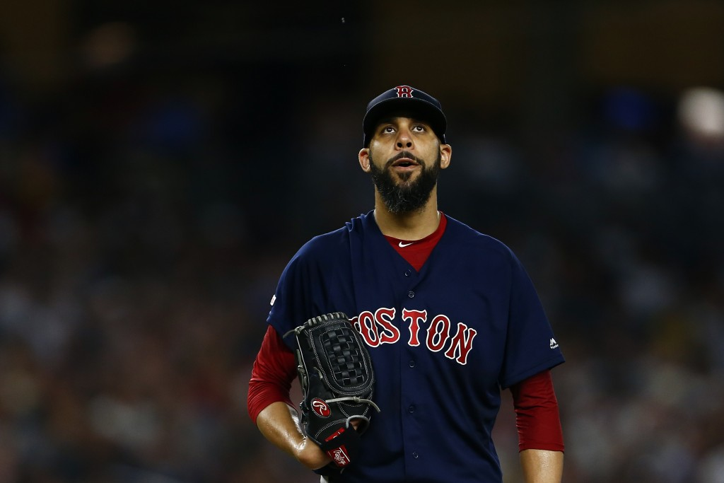 Boston Red Sox pitcher David Price reacts during the third inning of a baseball game against the New York Yankees on Sunday, Aug. 4, 2019, in New York...