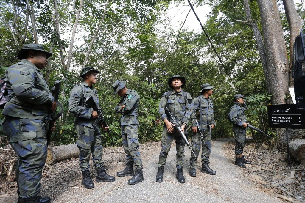 Members of General Operations Force arrive to join a search operation for a missing 15-year-old London schoolgirl at The Dusun resort in Seremban, Neg...