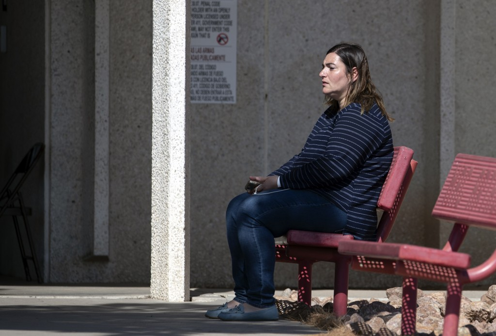 A relative of a victim of the Walmart mass shooting waits for information from authorities at the reunification center in El Paso, Texas, Sunday, Aug....