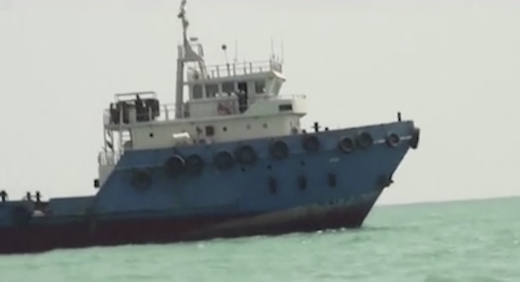 This undated image made from a video provided by the IRGC/IRIB shows a ship in the Persian Gulf. Iranian forces seized the ship, which it suspected of