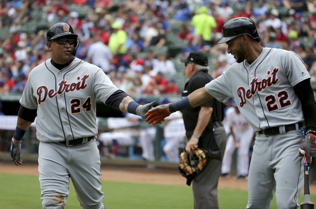 Detroit Tigers' Miguel Cabrera (24) is congratulated by Victor Reyes (22) after Cabrera scored against the Texas Rangers during the fourth inning of a...