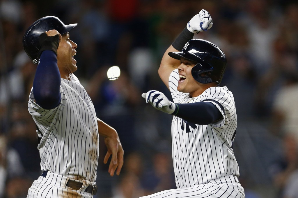 New York Yankees' Gio Urshela, right, celebrates his two- run home run with Aaron Judge, left, during the third inning of a baseball game against the ...