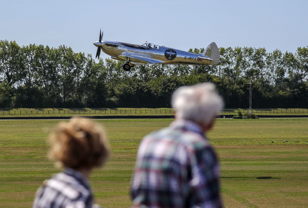 A restored MK IX Spitfire takes off from Goodwood Aerodrome in Goodwood, England, Monday, Aug. 5, 2019. A restored World War II Spitfire has taken off