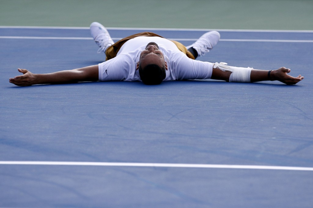 Nick Kyrgios, of Australia, falls to the court as he reacts after defeating Daniil Medvedev, of Russia, in a final match at the Citi Open tennis tourn...