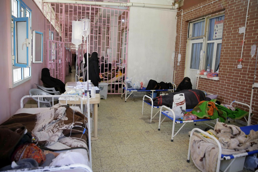 FILE - In this March 30, 2019 file photo, women are treated for suspected cholera infection at Al-Sabeen hospital, in Sanaa, Yemen. An Associated Pres...