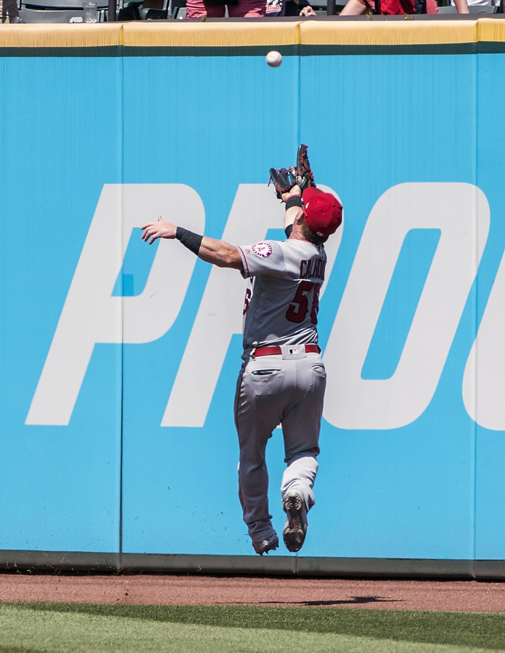 Los Angeles Angels' Kole Calhoun misses a fly ball by Cleveland Indians' Jordan Luplow during the fourth inning of a baseball game in Cleveland, Sunda...
