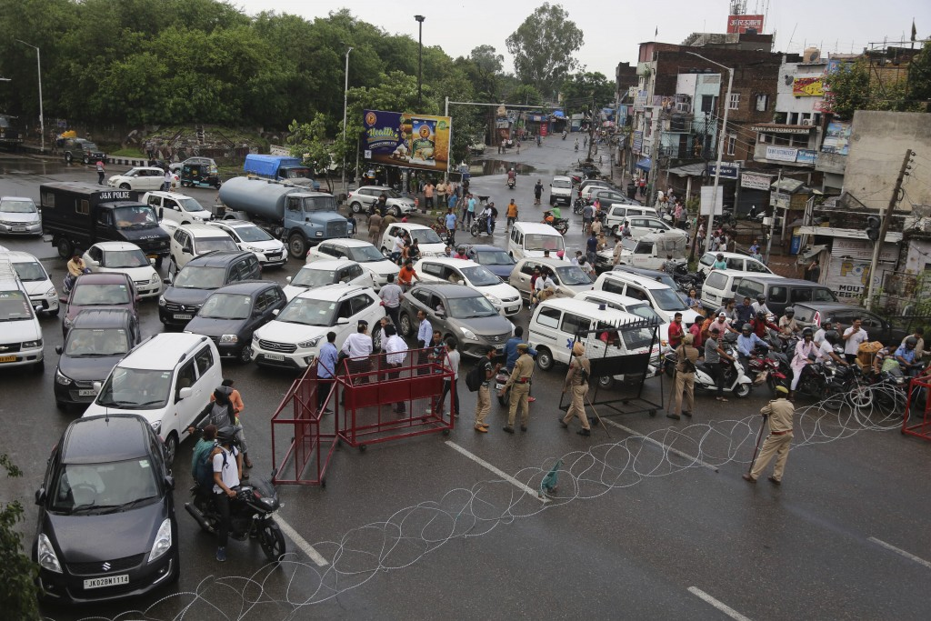 Barricades are set up by Indian police to prevent the moment of vehicles during curfew like restrictions in Jammu, India, Monday, Aug. 5, 2019. An ind...