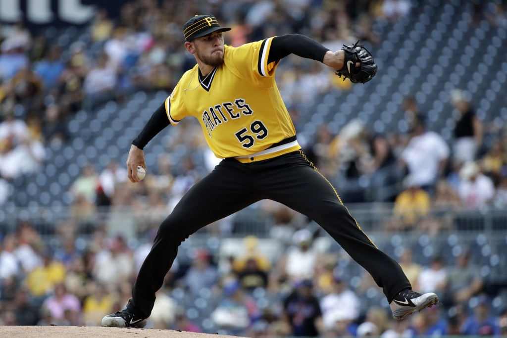 Pittsburgh Pirates starting pitcher Joe Musgrove delivers during the first inning of a baseball game against the New York Mets in Pittsburgh, Sunday, ...