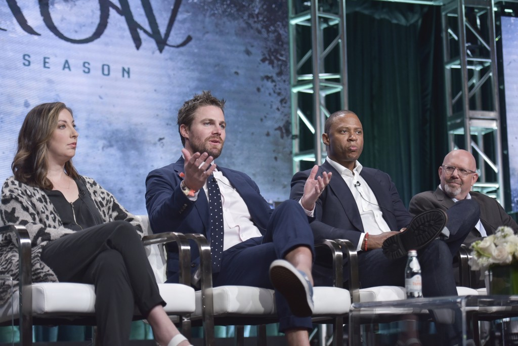 "Beth Schwartz, from left, Stephen Amell, David Ramsey and Marc Guggenheim participate in The CW ""Arrow: Final Season"" panel during the Summer 2019 Tel"