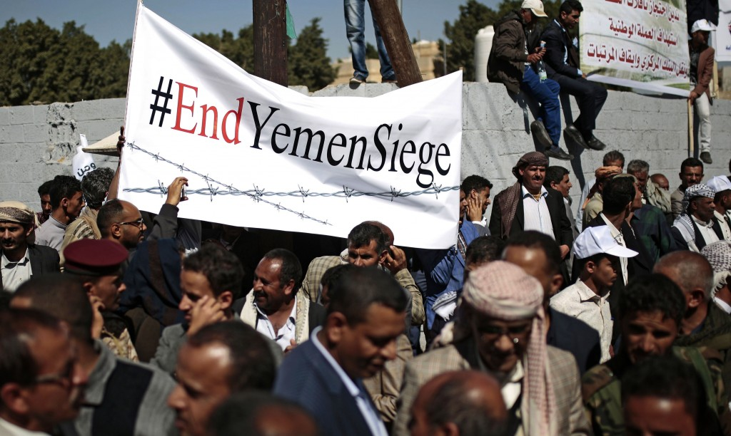 FILE - In this Dec. 10, 2018 file photo, Yemenis take part in a protest calling for the reopening of Sanaa airport to receive medical aid, in front of