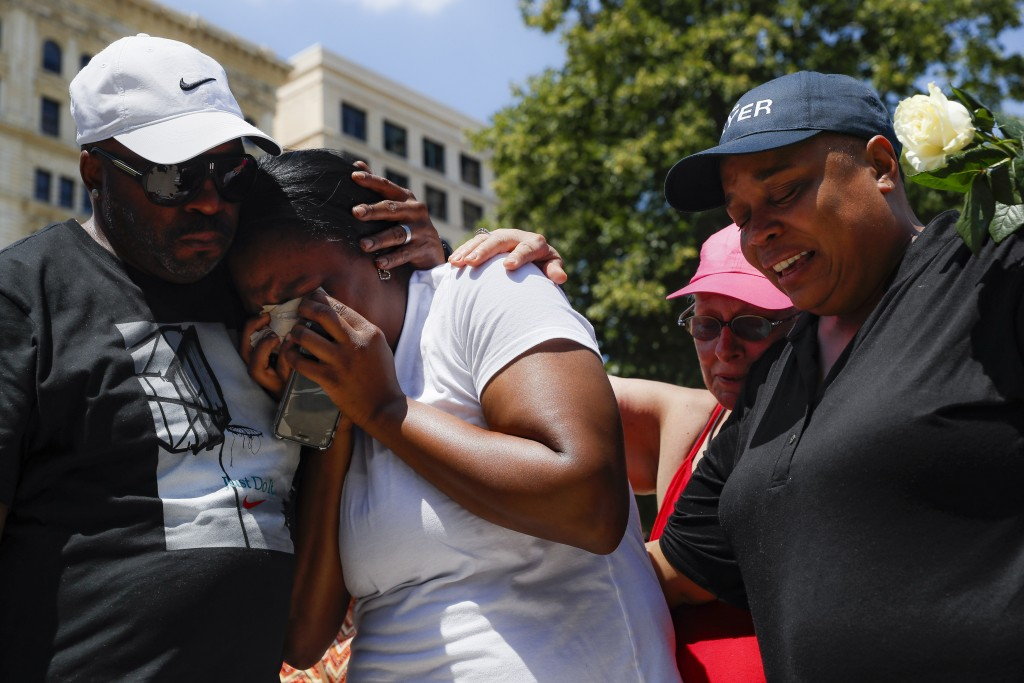 Mourners gather at a vigil following a nearby mass shooting, Sunday, Aug. 4, 2019, in Dayton, Ohio. Multiple people in Ohio have been killed in the se