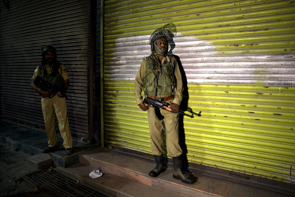 Indian soldiers stand guard in the night in Srinagar, India, Sunday, Aug. 4, 2019. Tensions have soared along the volatile, highly militarized frontie