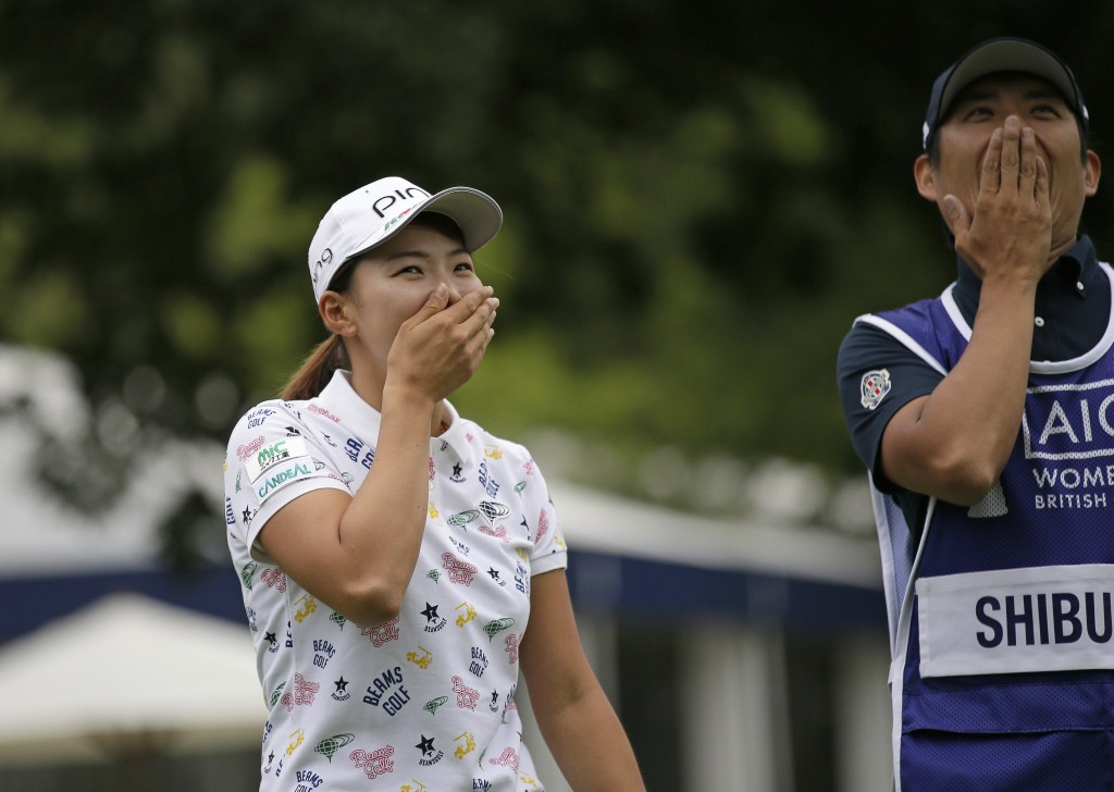 Japan's Hinako Shibuno celebrates alongside her caddie after winning the Women's British Open golf championship at Woburn Gold Club near near Milton K