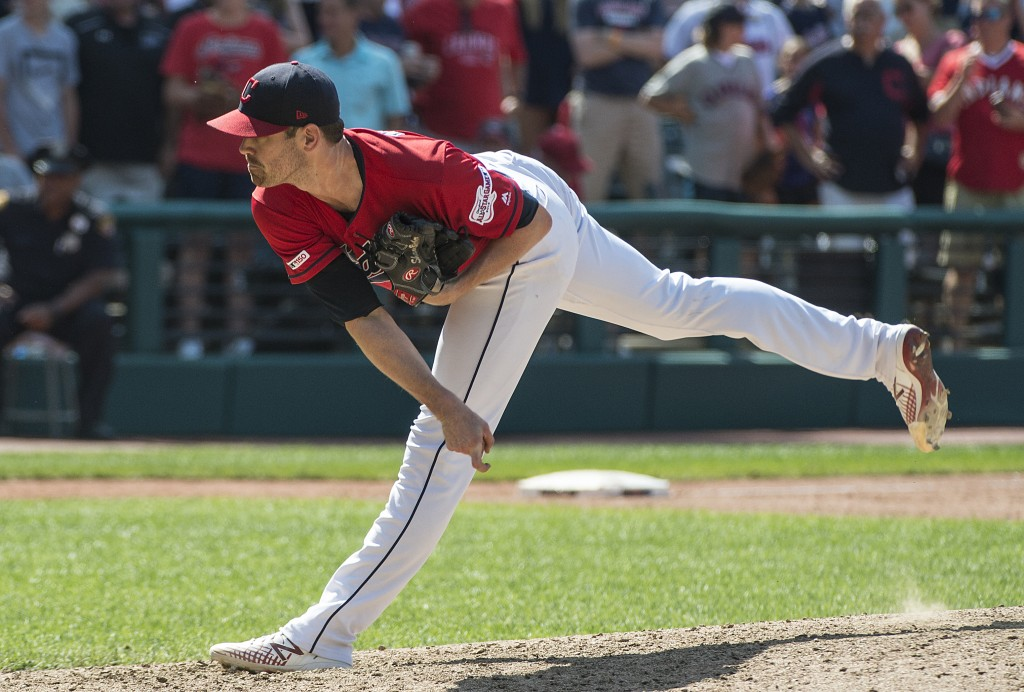 Cleveland Indians starting pitcher Shane Bieber strikes out Los Angeles Angels' Shohei Ohtani during the ninth inning of a baseball game in Cleveland,...
