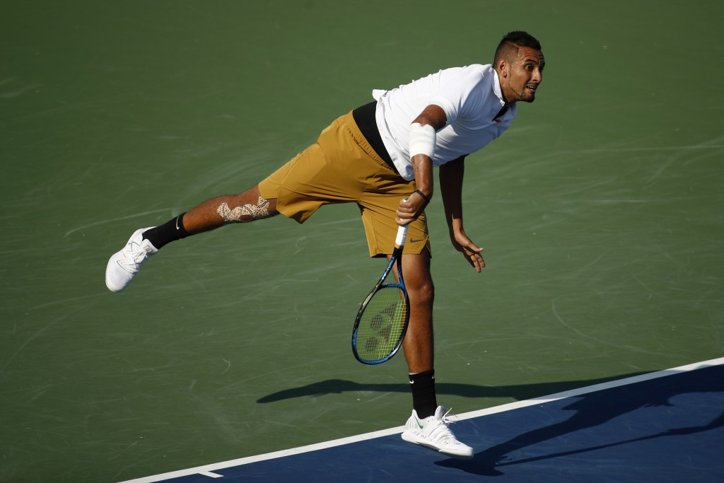 Nick Kyrgios, of Australia, follows through on a serve to Daniil Medvedev, of Russia, during a final match at the Citi Open tennis tournament, Sunday,...