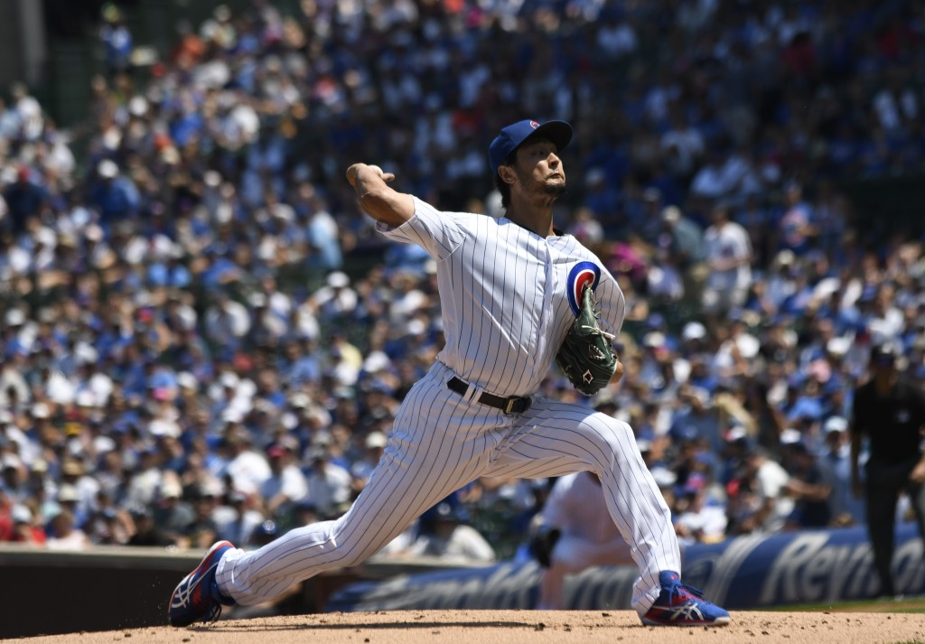 Chicago Cubs starting pitcher Yu Darvish (11) throws the ball during the first inning of a baseball game against the Milwaukee Brewers, Sunday, Aug. 4...