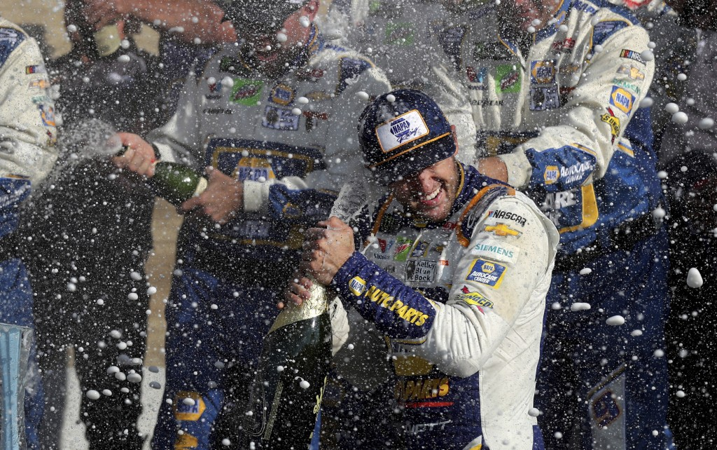 Chase Elliott celebrates his victory with his pit crew after winning a NASCAR Cup Series auto race at Watkins Glen International, Sunday, Aug. 4, 2019