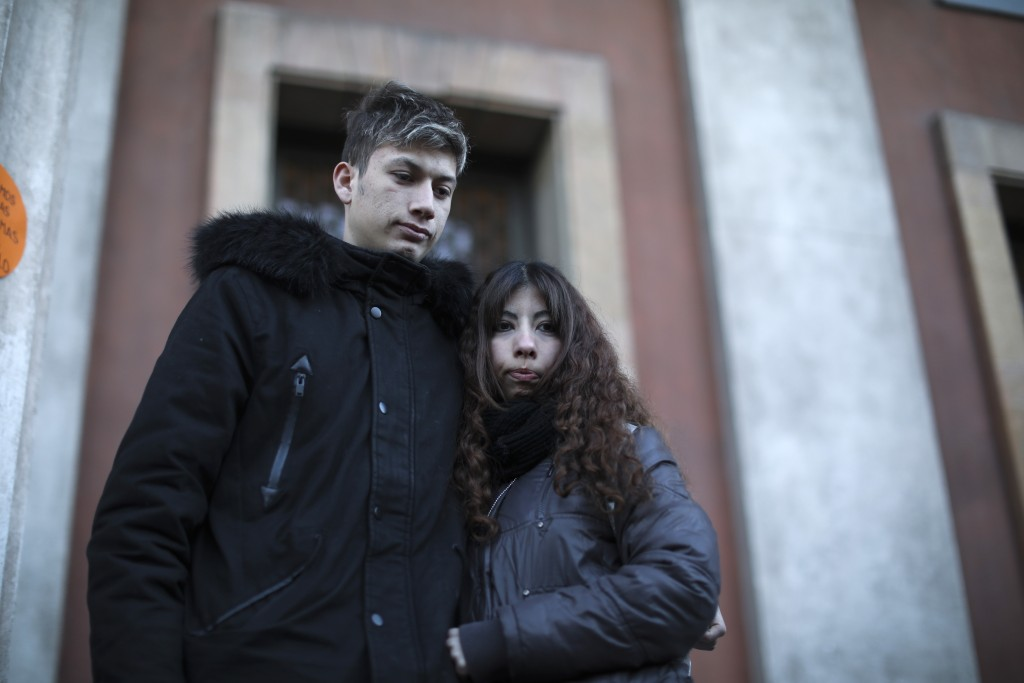 Ezequiel Villalonga, left, an alleged sexual assault victim, stands outside the courtroom with his girlfriend Jimena Capaldi, in Mendoza, Argentina, M...