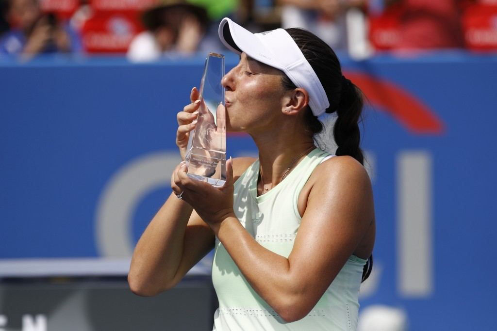 Jessica Pegula poses with a trophy after defeating Camila Giorgi, of Italy, in a final match at the Citi Open tennis tournament, Sunday, Aug. 4, 2019,