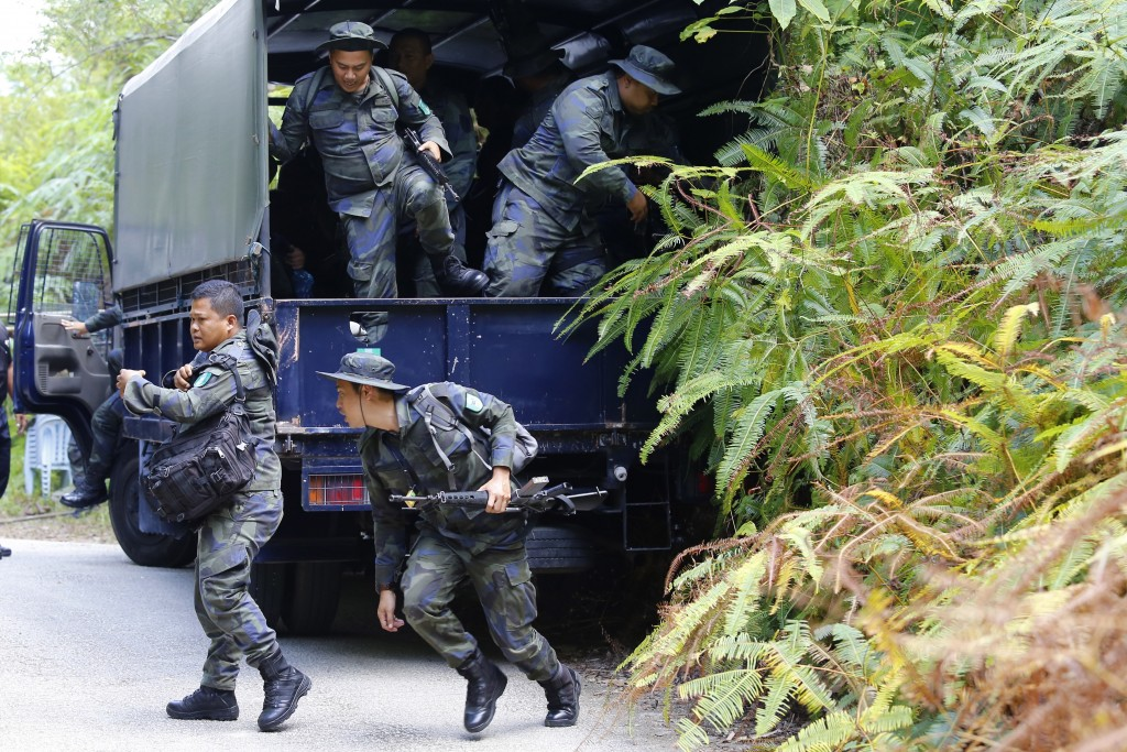 Members of General Operations Force arrive to join a search operation for a missing15-year-old London schoolgirl at The Dusun resort in Seremban, Nege