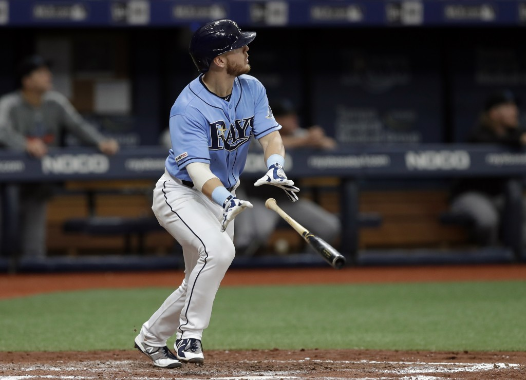 Tampa Bay Rays' Michael Brosseau drops his bat as he watches his solo home run off Miami Marlins starting pitcher Caleb Smith during the third inning ...