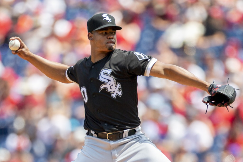 Chicago White Sox starting pitcher Reynaldo Lopez (40) throws during the first inning of a baseball game against the Philadelphia Phillies, Sunday, Au