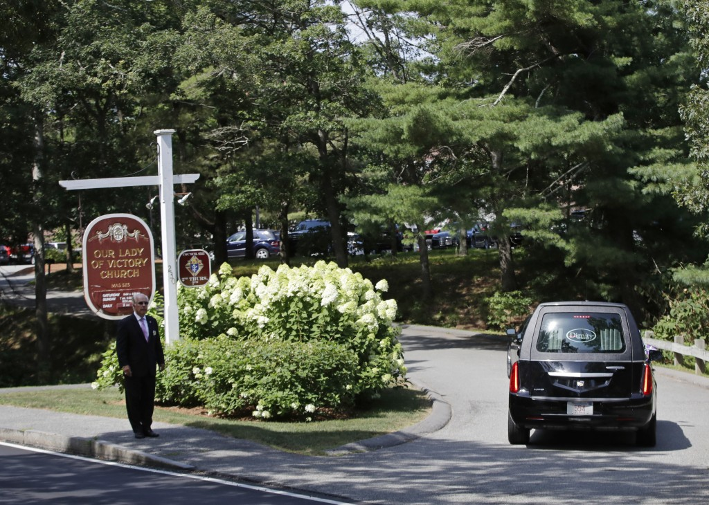 A hearse carrying the casket of Saoirse Kennedy Hill, the 22-year-old granddaughter of the late Robert F. Kennedy, enters the driveway at Our Lady of