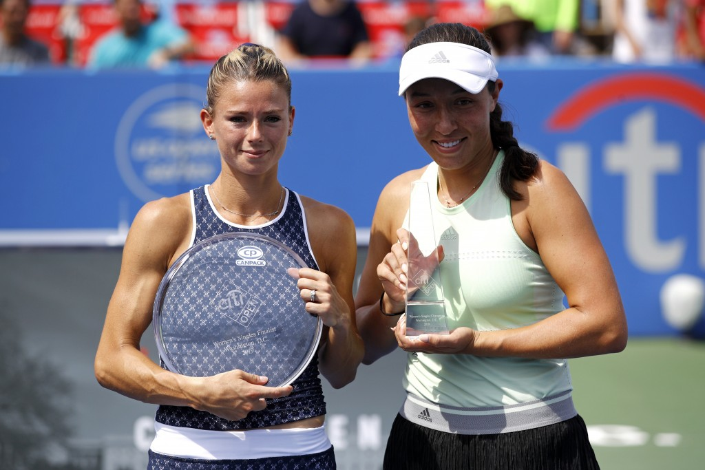 Runner-up Camila Giorgi, left, of Italy, and winner Jessica Pegula pose for photographs after a final match at the Citi Open tennis tournament, Sunday