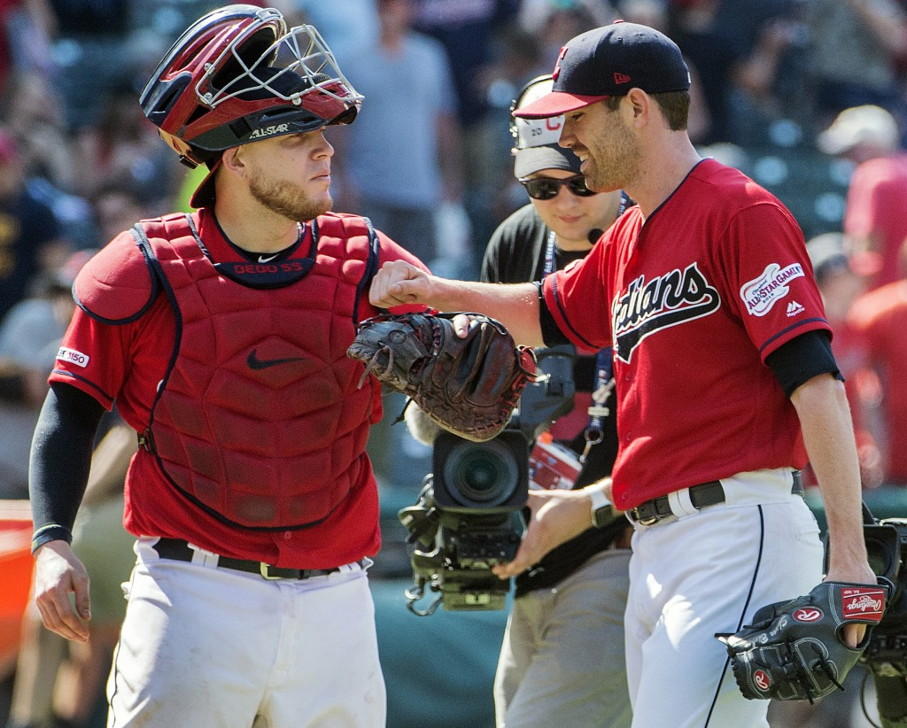 Cleveland Indians' Roberto Perez, left, and starter Shane Bieber celebrate their win over the Los Angeles Angels in a baseball game in Cleveland, Sund...