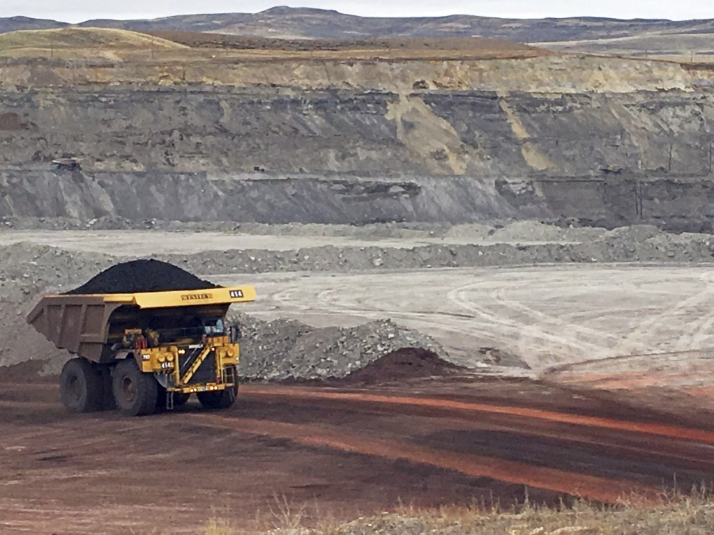 FILE - In this March 28, 2017, file photo, a dump truck hauls coal at Contura Energy's Eagle Butte Mine near Gillette, Wyo. Contura Energy has made a ...