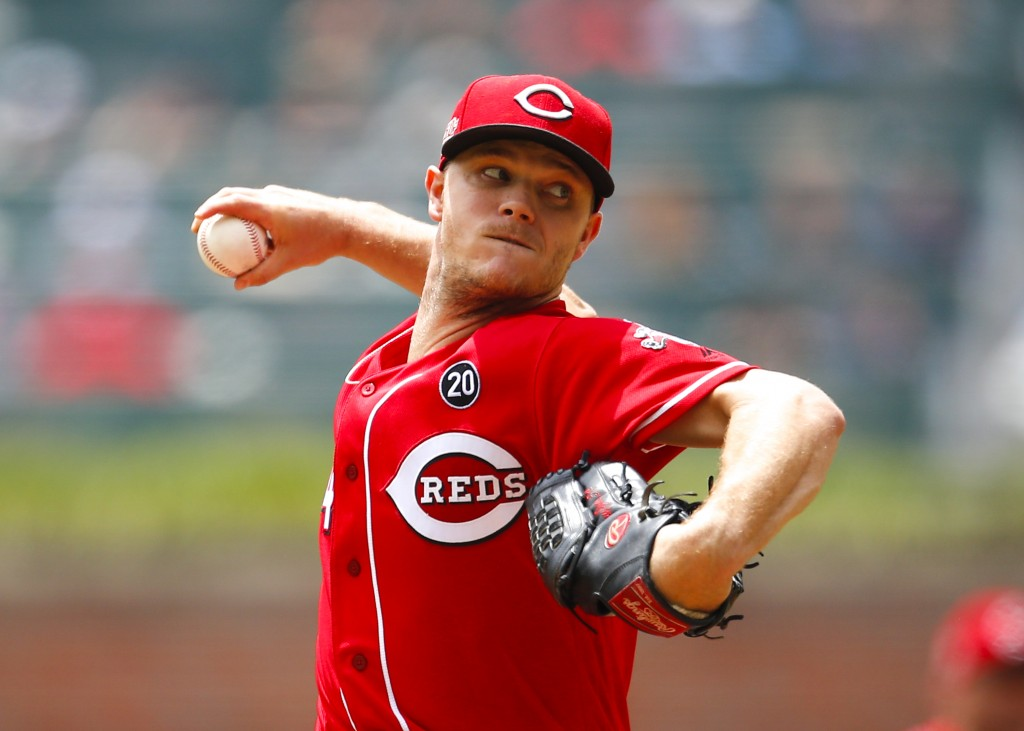 Cincinnati Reds starting pitcher Sonny Gray delivers in the first inning of a baseball game against the Atlanta Braves, Sunday, Aug.4, 2019, in Atlant...