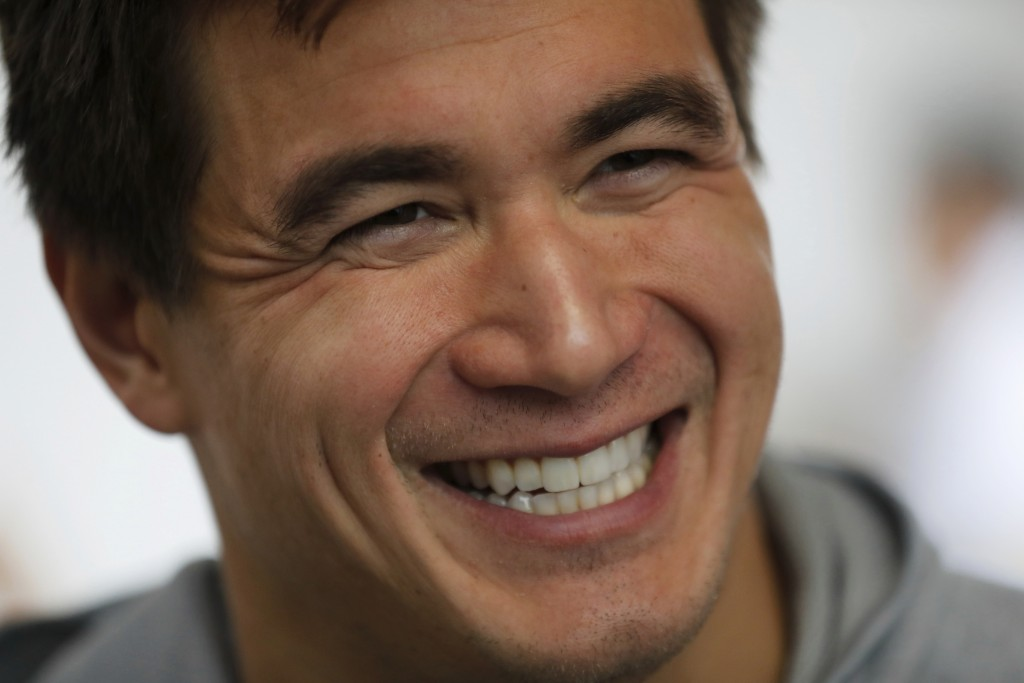 Nathan Adrian, a swimmer from the United States, smiles during an interview at the swimming complex of the Pan American Games in Lima, Peru, Monday, A...