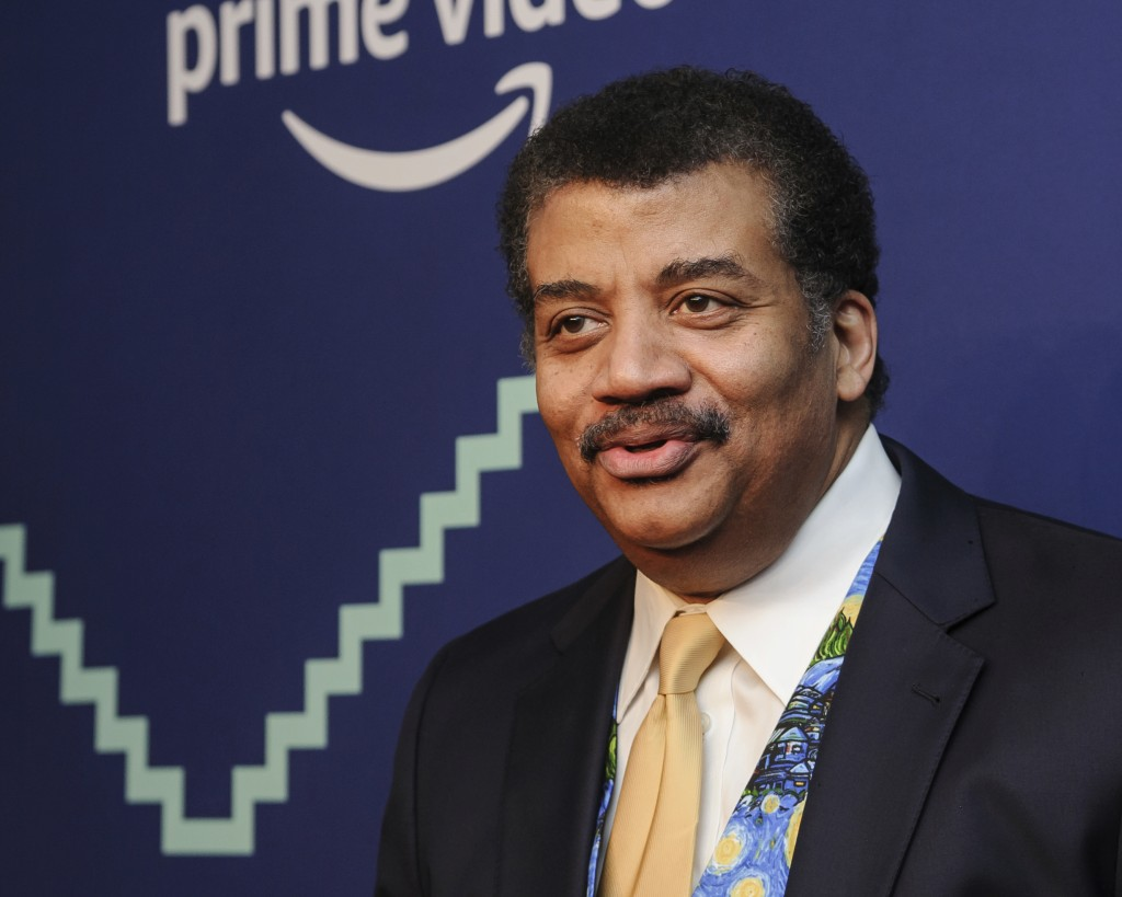 File-This May 13, 2019, file photo shows Neil Degrasse Tyson attending the 23rd annual Webby Awards at Cipriani Wall Street in New York. DeGrasse Tyso...