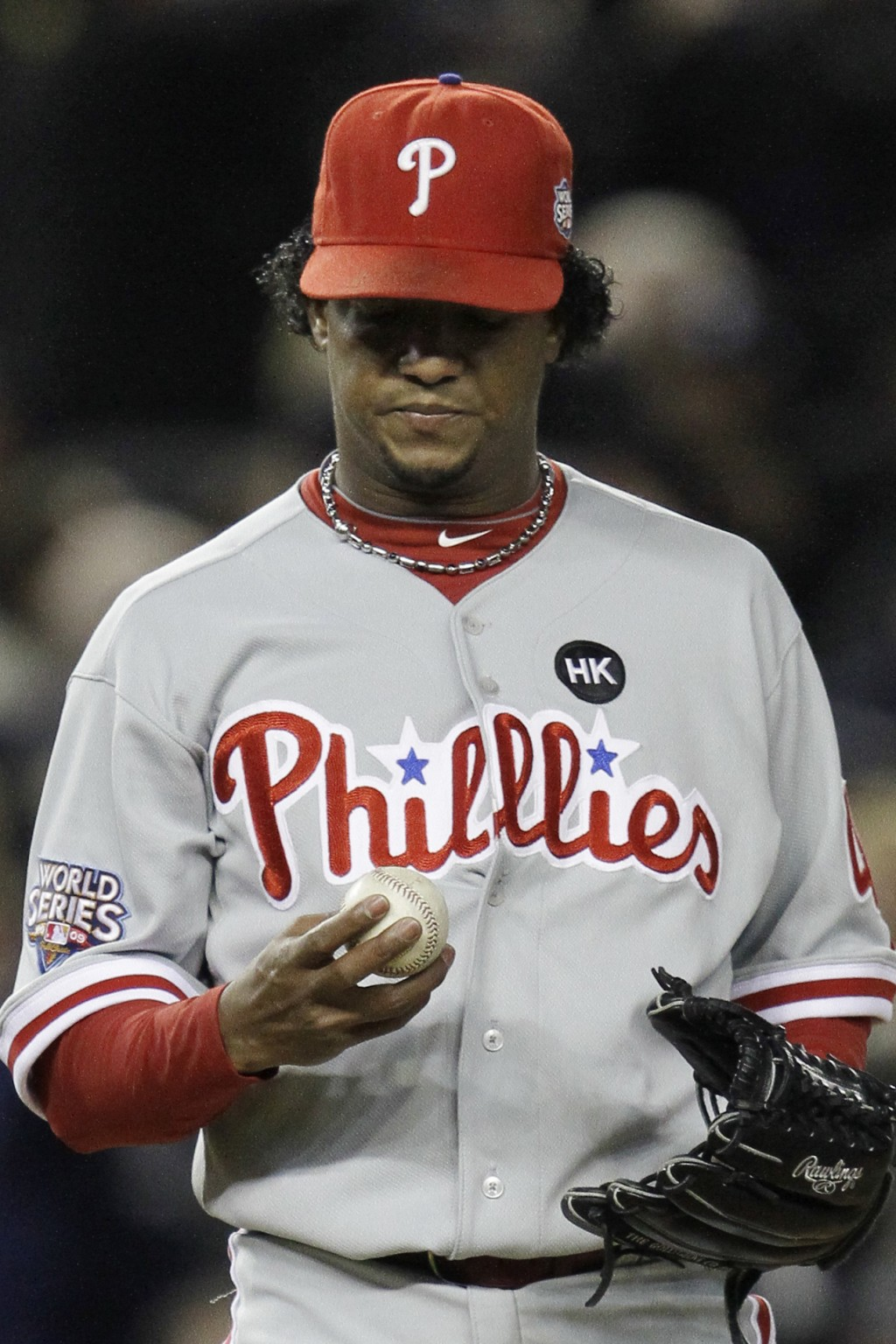 FILE - In this Nov. 4, 2009, file photo, Philadelphia Phillies' Pedro Martinez looks at his ball after giving up a two-run home run to New York Yankee