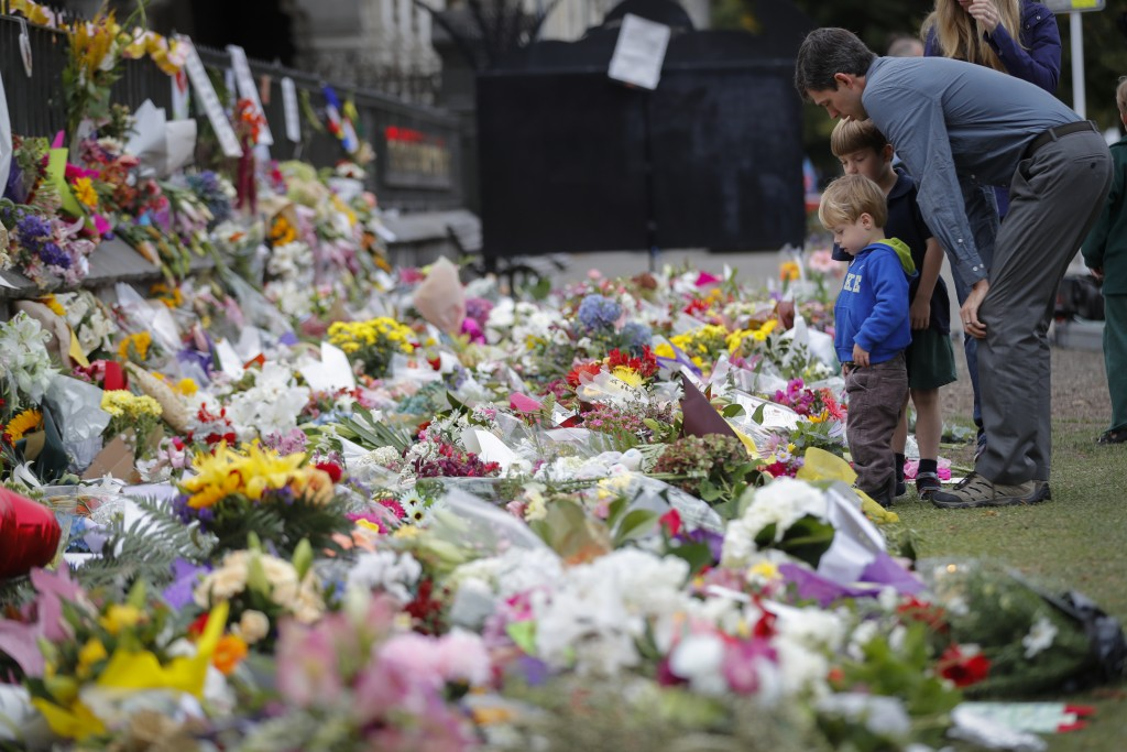 FILE - In this March 18, 2019, file photo, mourners lay flowers on a wall at the Botanical Gardens in Christchurch, New Zealand. The El Paso massacre ...
