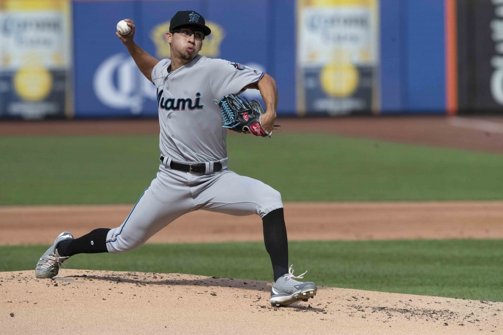 Miami Marlins starting pitcher Robert Dugger delivers in his major league debut during the first inning of a baseball game against the New York Mets, ...