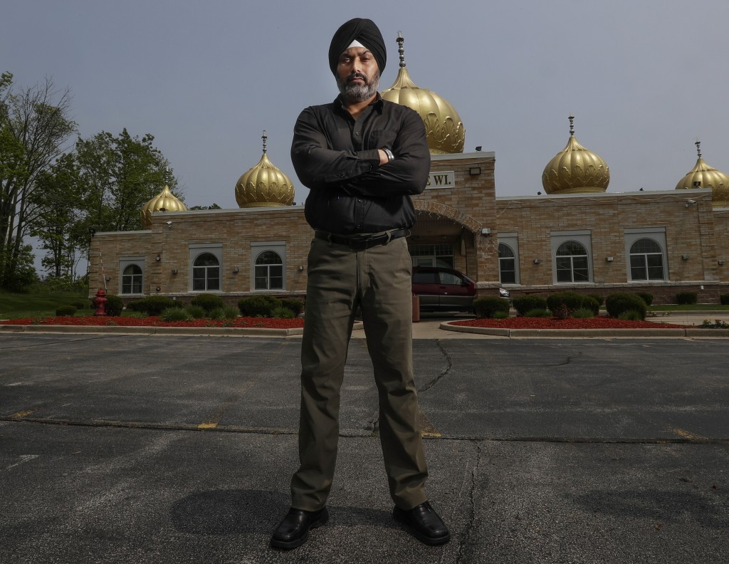 FILE - In this June 1, 2019, file photo, Pardeep Singh Kaleka poses for a portrait outside the Sikh Temple in Oak Creek, Wis. Kaleka, whose father was