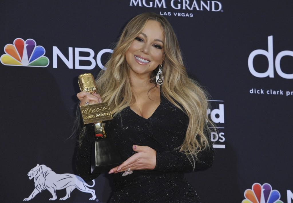 FILE - In this May 1, 2019, file photo Mariah Carey poses in the press room with the Icon award at the Billboard Music Awards at the MGM Grand Garden