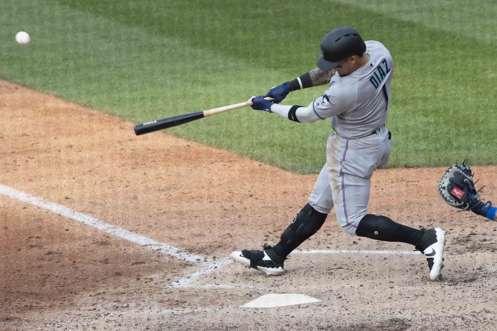 Miami Marlins' Isan Diaz hits a home run in his major league debut during the sixth inning of a baseball game against the New York Mets, Monday, Aug. ...