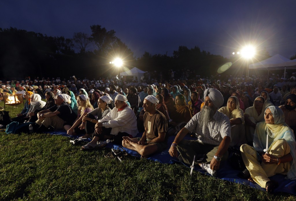 FILE - In this Aug. 5, 2013, file photo hundreds participate in a candlelight vigil at the Sikh Temple of Wisconsin to mark the one-year anniversary o