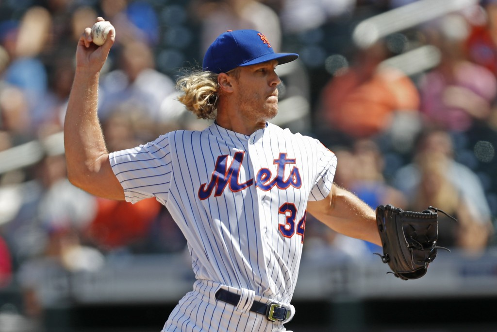 New York Mets starting pitcher Noah Syndergaard (34) winds up during the first inning of a baseball game against the Philadelphia Phillies, Sunday, Se